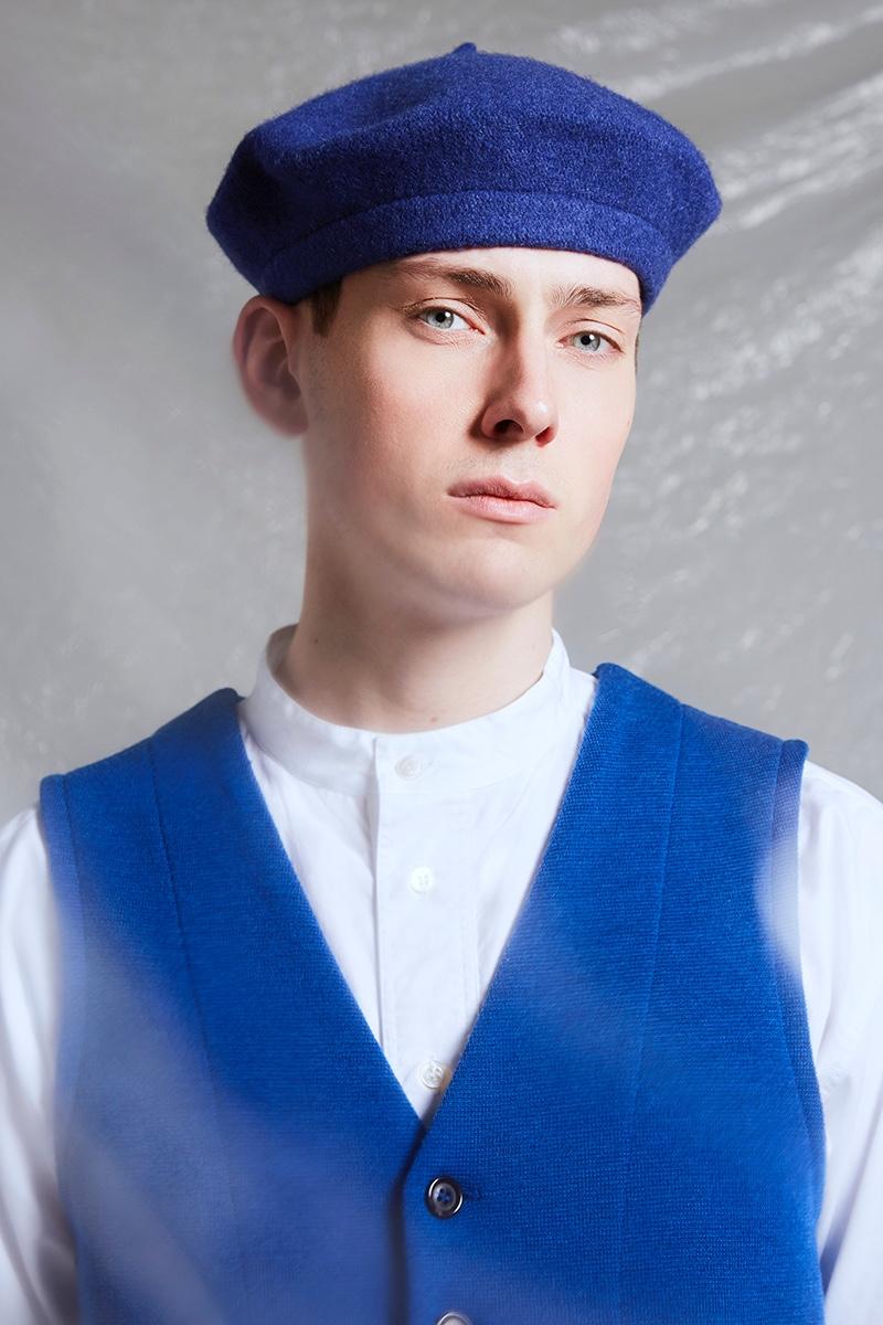 Hubert wears beret ASOS, vest and shirt Omen.