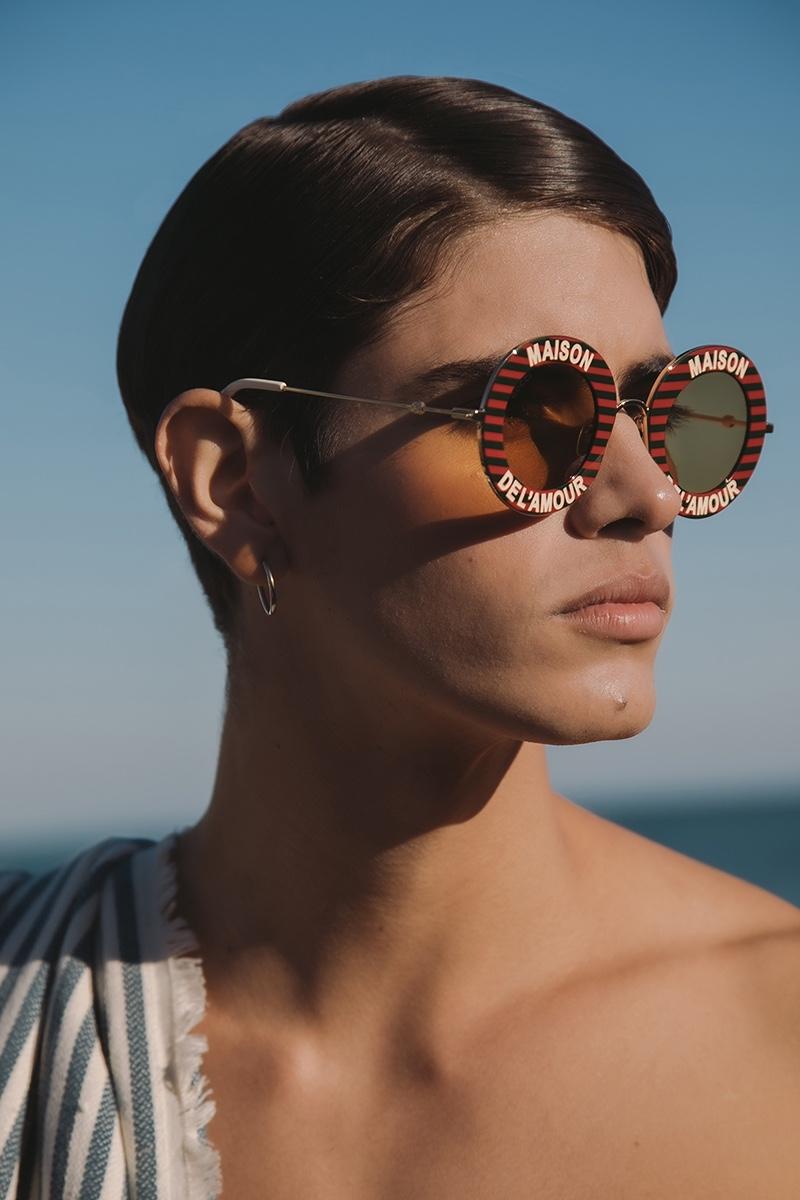 Sergio wears sunglasses Gucci.