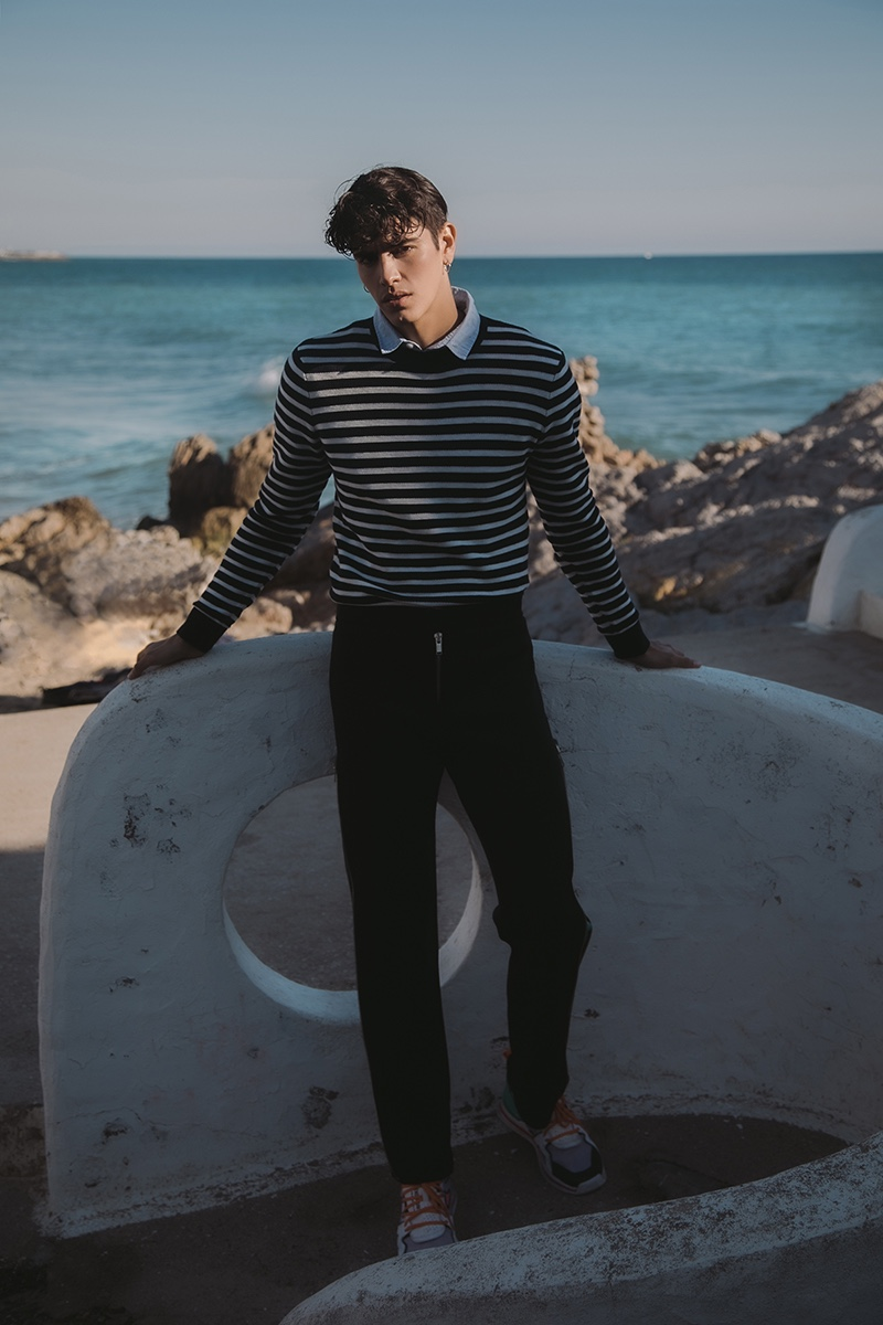 Sergio wears pants Violera Arellano, sweater Scotch & Soda, and shirt Tommy Hilfiger.