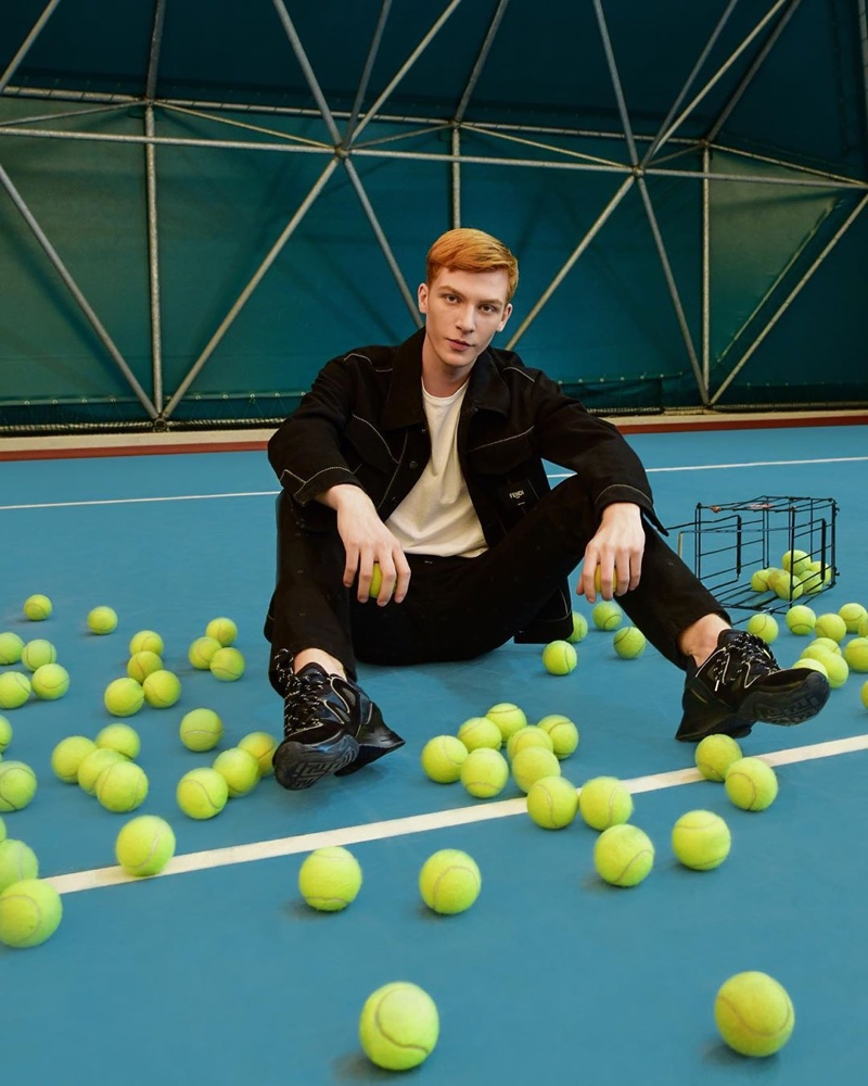 Polish model Simon Gano sports a pair of Fendi FFluid sneakers.