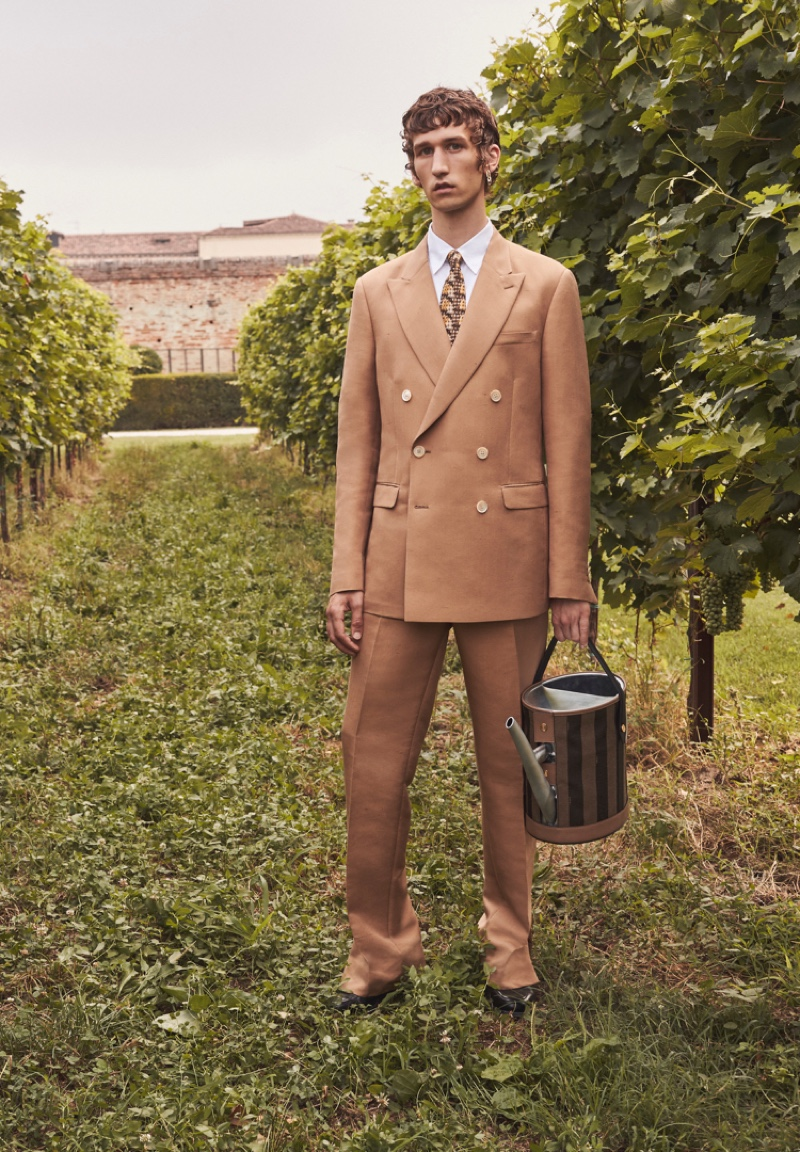 Donning a tan double-breasted suit, Etienne de Testa stars in Fendi's spring-summer 2020 campaign.