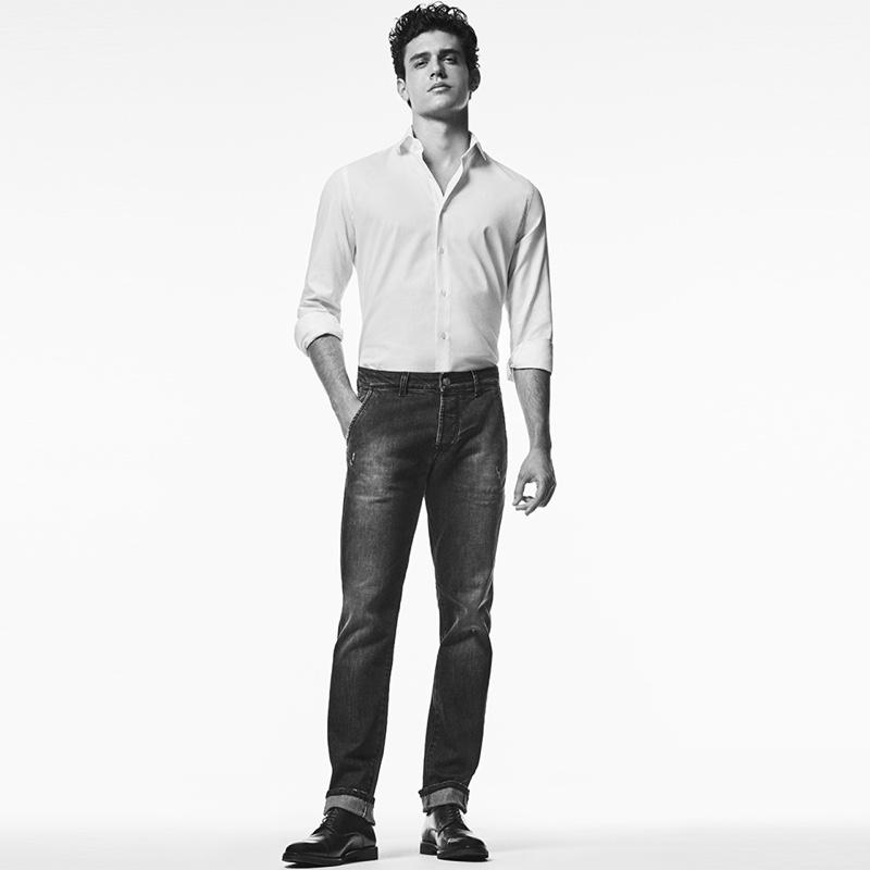 Taking to the studio, Xavier Serrano sports Liu Jo Uomo's chino-fit denim jeans.