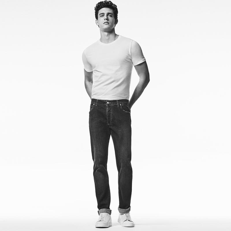 Sporting a t-shirt and regular fit jeans, Xavier Serrano wears Liu Jo Uomo.