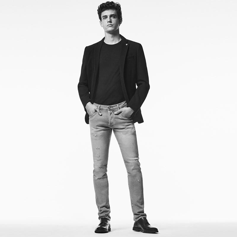 Model Xavier Serrano dons slim jeans from Liu Jo Uomo.