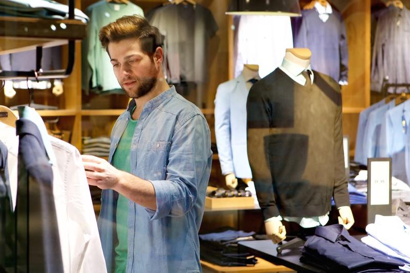 Man Choosing Clothes Store Window