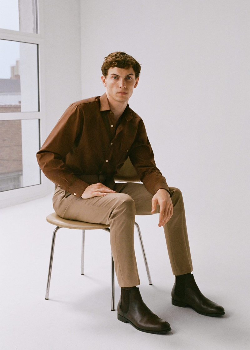 Embracing shades of brown, Luc Defont-Saviard wears Mango.