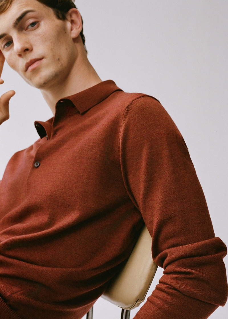 Model Luc Defont-Saviard dons a long-sleeve polo by Mango.
