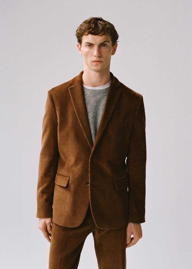 Luc Defont-Saviard dons a brown corduroy suit from Mango.