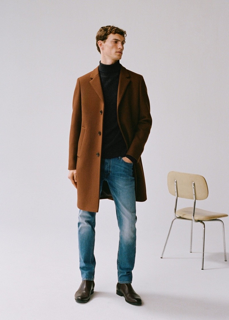 Going smart casual, Luc Defont-Saviard dons a single-breasted coat with a turtleneck sweater and distressed denim jeans from Mango.