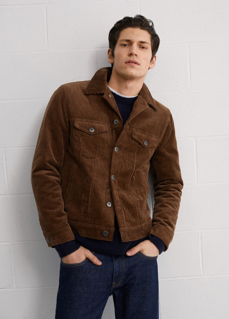 Corduroy is back in style as Justin Eric Martin wears a brown jacket from Mango.