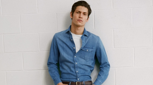 Rocking a denim shirt and jeans, Justin Eric Martin wears a double denim look from Mango.