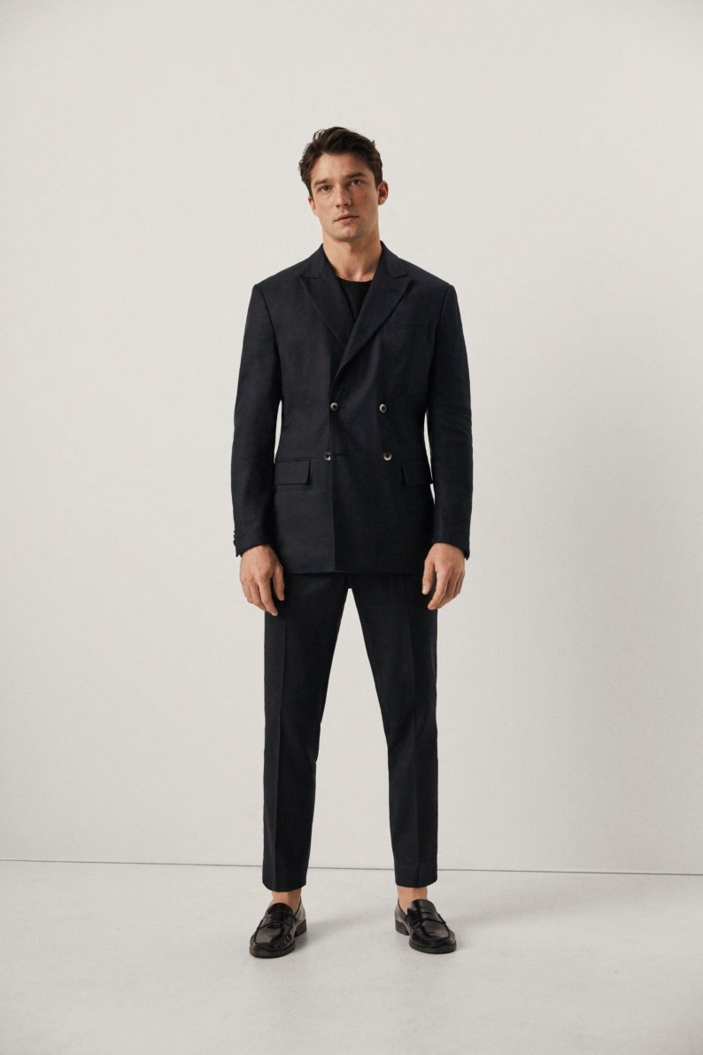Donning a double-breasted suit, Alexis Petit sports Mango.