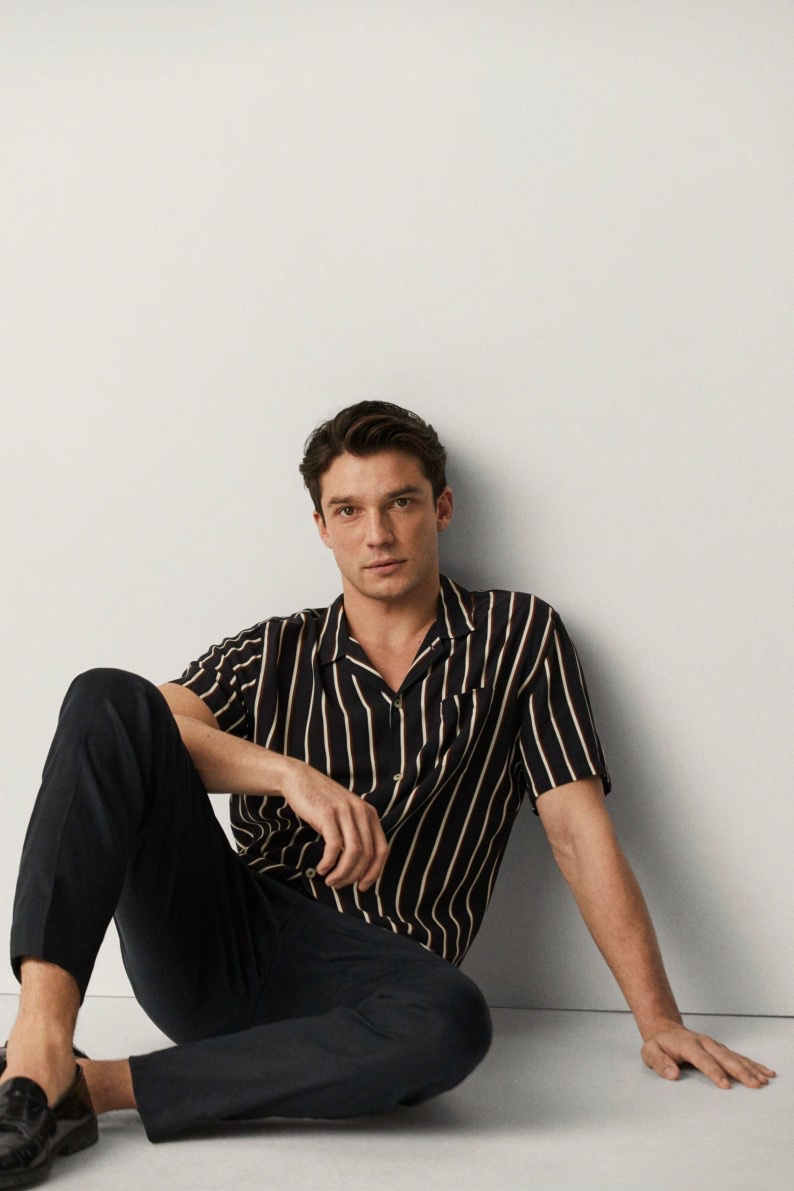 Model Alexis Petit wears a striped short-sleeve shirt with trousers from Mango.