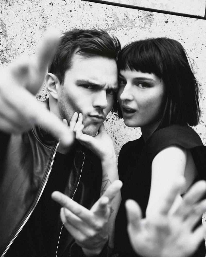 Nicholas Hoult and Alice Pagani pose for a behind the scenes image by photographer Damon Baker.