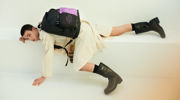 Nika Jovanovic sports a backpack from the Raf Simons x Eastpak spring-summer 2020 collection.