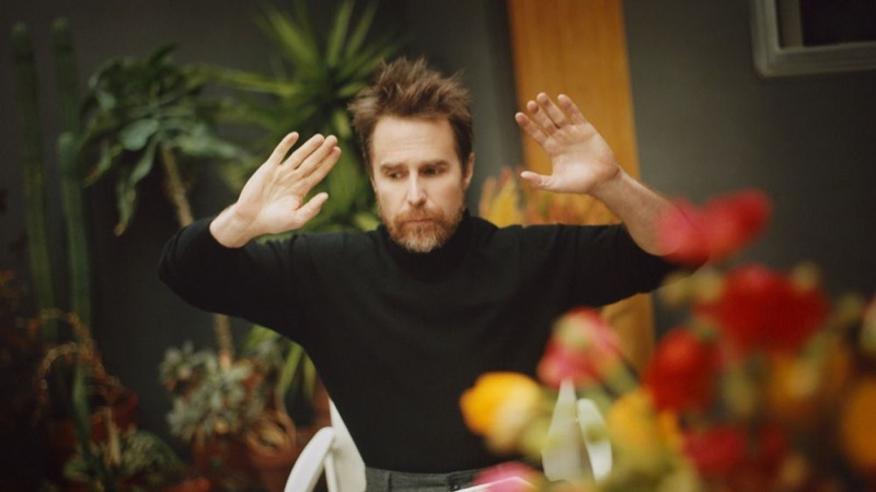 Sam Rockwell sports an Altea cashmere turtleneck sweater with Mr P. wide-leg trousers.