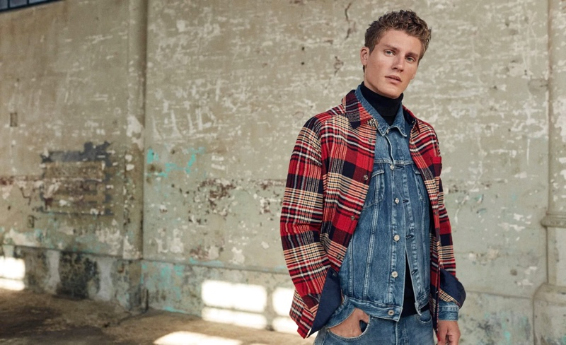 Front and center, Mikkel Jensen doubles down on Scotch & Soda denim. He completes his look with a plaid overshirt.