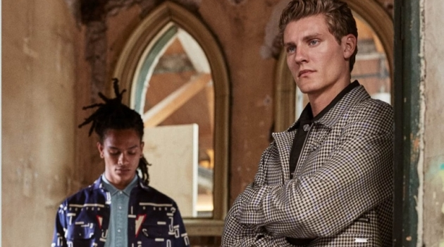 Olajuwon Anderson and Mikkel Jensen wear new season styles from Scotch & Soda. Pictured left, Olajuwon sports a pair of the brand's statement striped cargo pants. Meanwhile, Mikkel dons a houndstooth jacket.