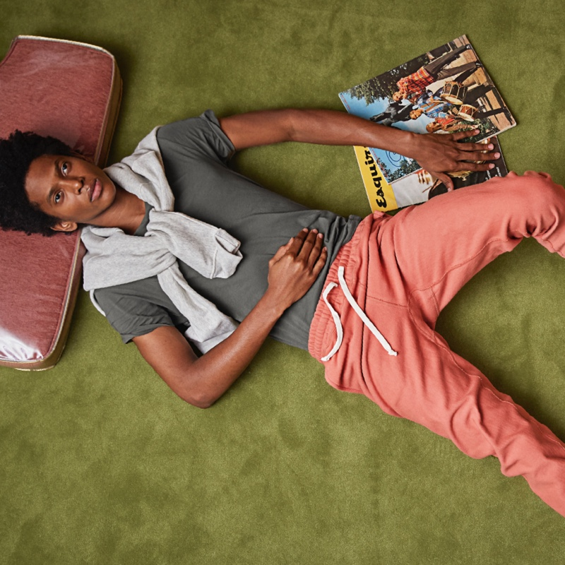 Embracing a retro style theme, Rafael Mieses wears Todd Snyder + Champion orange russet terry classic sweatpants.
