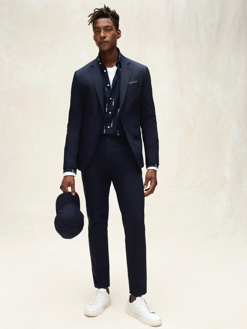 Ty Ogunkoya dons a sleek navy suit from Tommy Hilfiger Tailored's spring-summer 2020 collection.