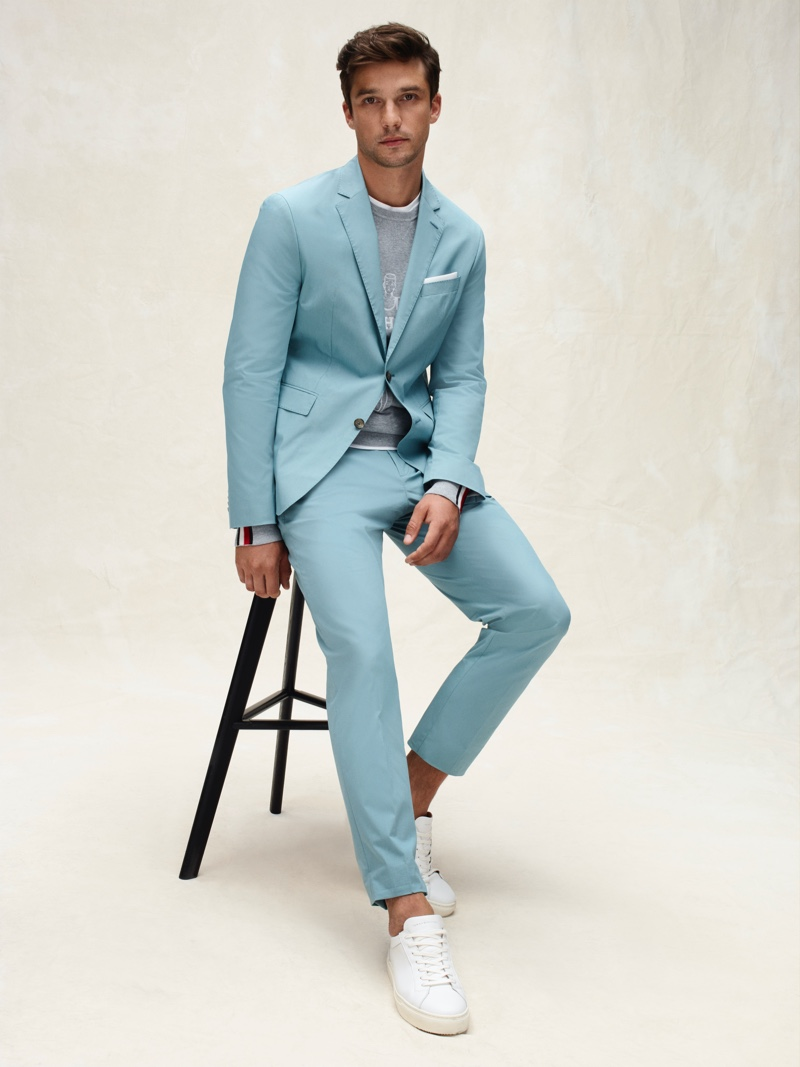 Embracing a pop of color, Alexis Petit sports a suit from Tommy Hilfiger Tailored's spring-summer 2020 collection.