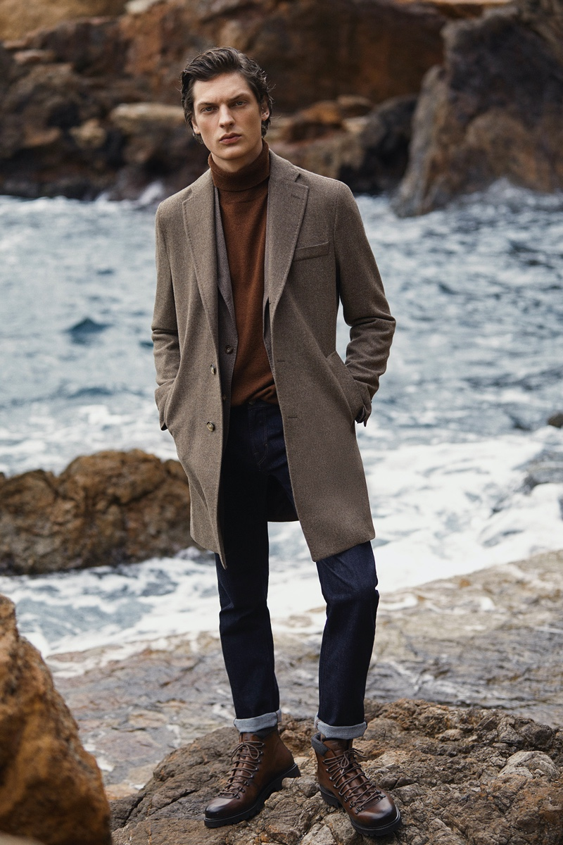 Valentin Caron dons a smart outfit with jeans, a coat, and more from Massimo Dutti.