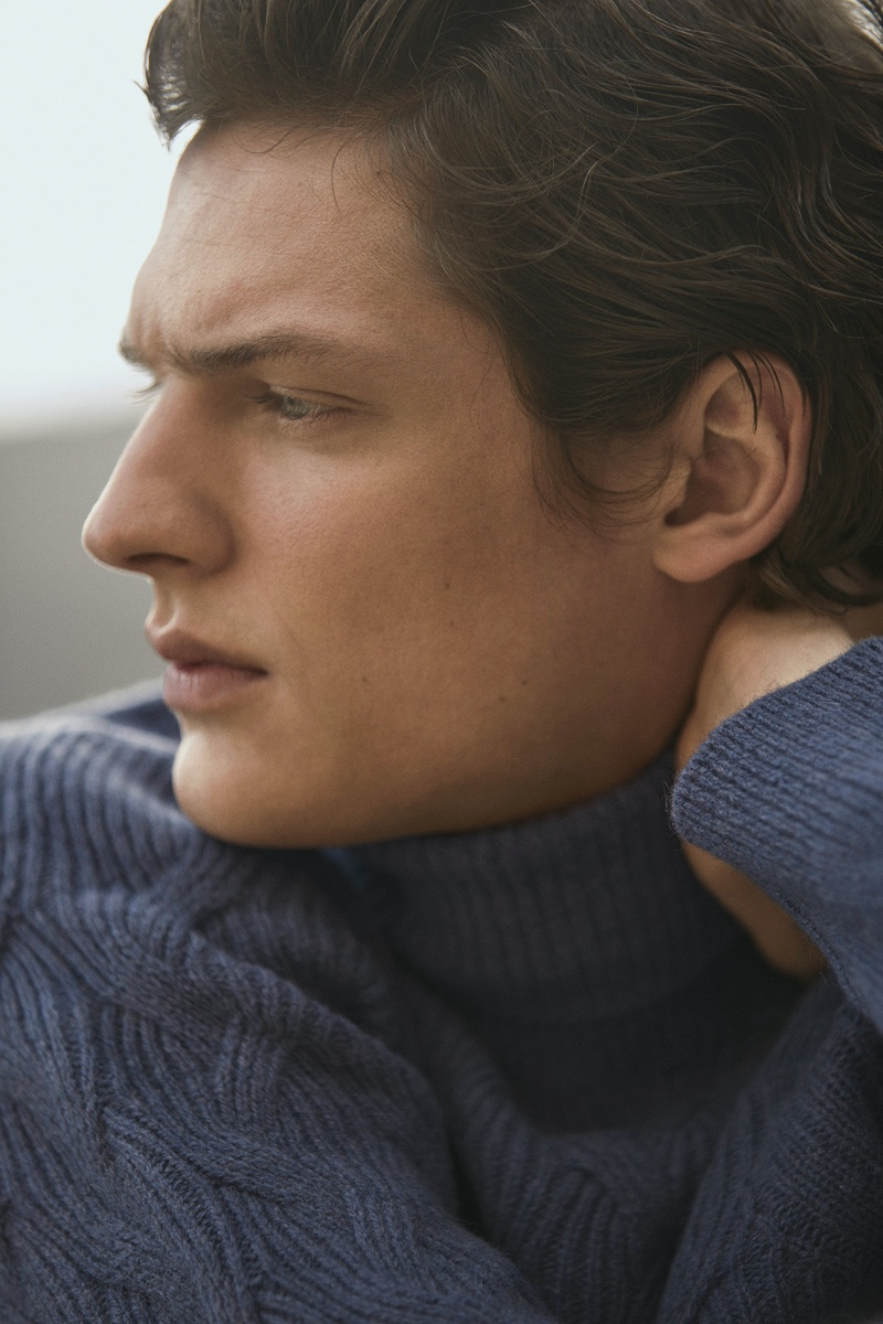 Model Valentin Caron sports a textured knit sweater by Massimo Dutti.