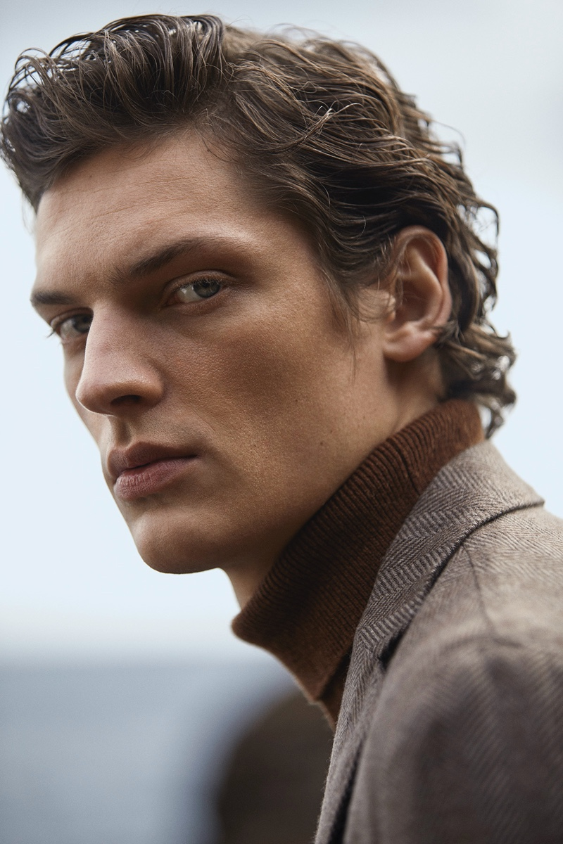 Ready for his close-up, Valentin Caron models a turtleneck sweater and suit jacket by Massimo Dutti.
