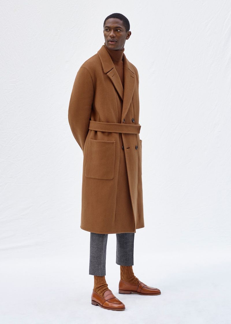 Hamid Onifade embraces monochromatic style in a brown coat and sweater from Agnona's fall-winter 2020 collection.