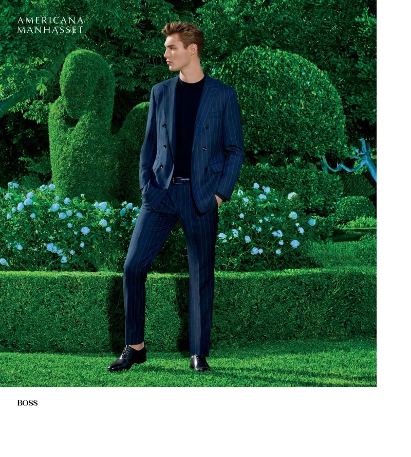 Donning a sharp pinstripe suit in navy, Kit Butler wears BOSS.