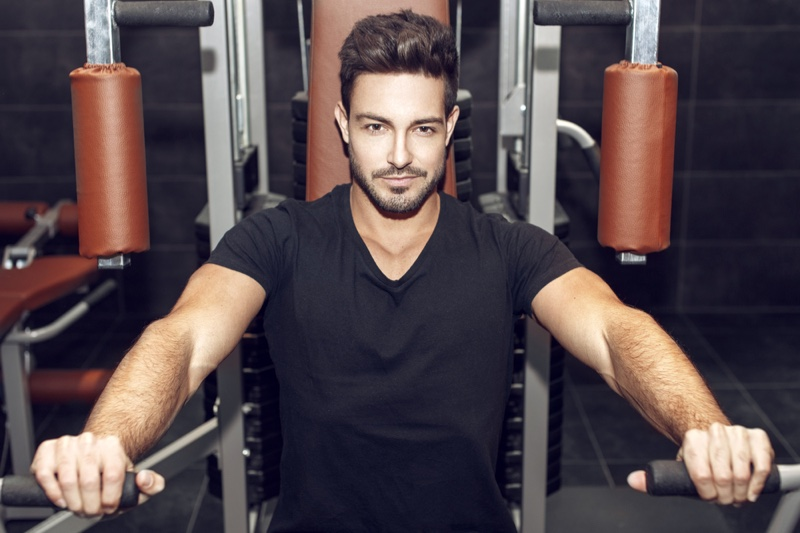 Attractive Man Black V-Neck Shirt Working Out