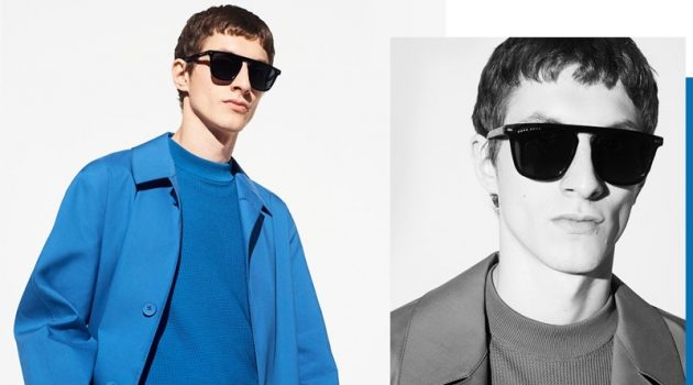 Embracing monochromatic style, Henry Kitcher wears a blue short-sleeve sweater and coat from BOSS.