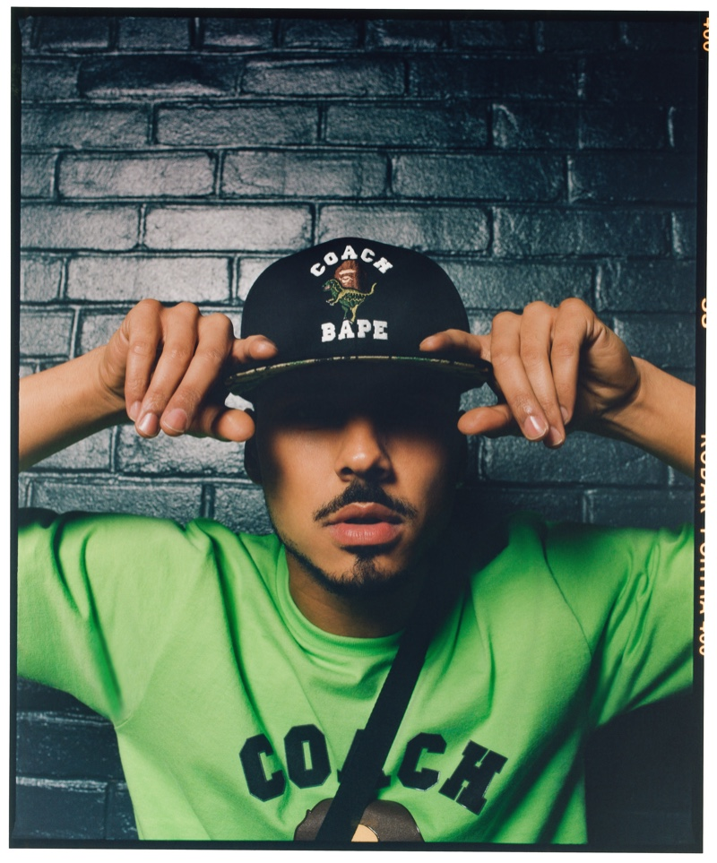 A cool vision, Quincy Brown wears a cap and t-shirt from the Bape x Coach collection.