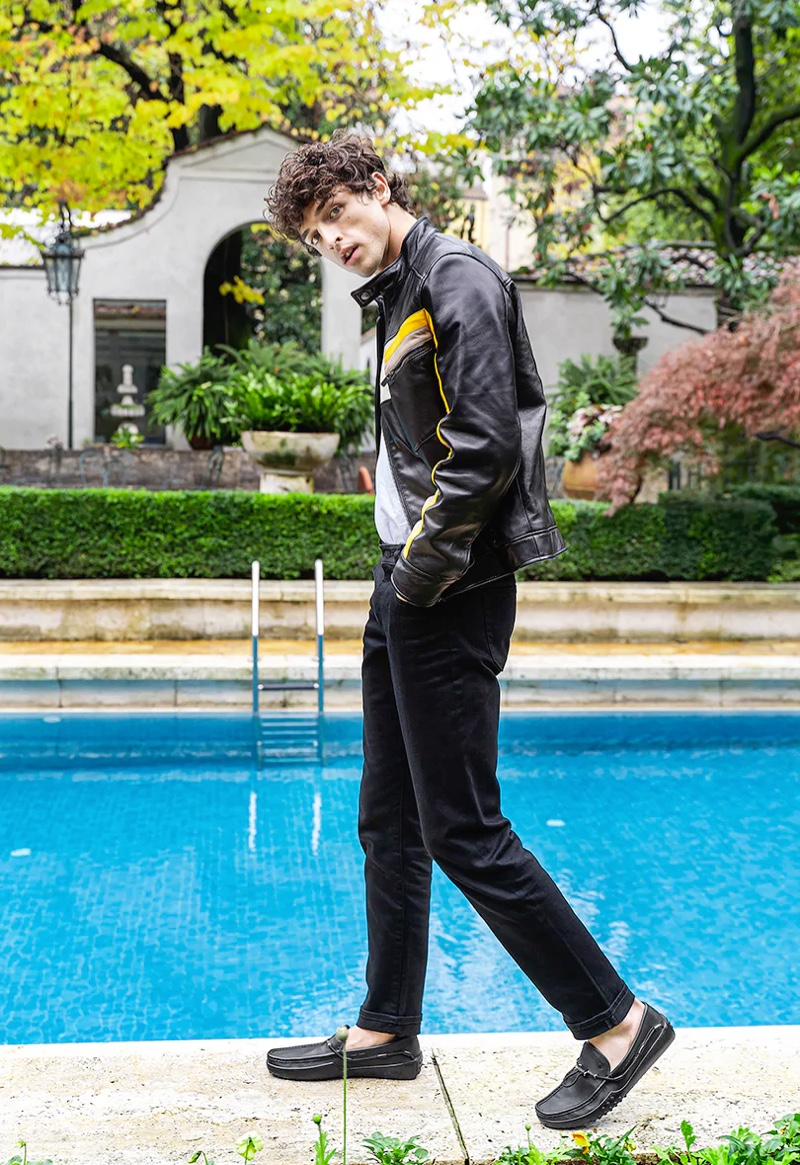 Pictured poolside, Alberto Perazzolo poses behind the scenes of Tod's spring-summer 2020 campaign.