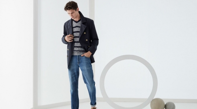 Arthur Gosse dons a double-breasted jacket with a v-neck sweater and jeans by Brunello Cucinelli.
