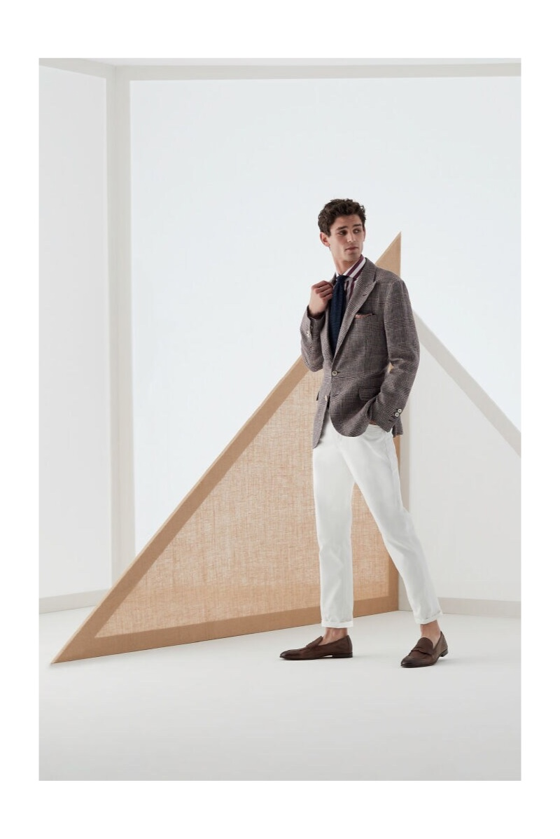 Embracing smart style, Arthur Gosse models a dashing look from Brunello Cucinelli.