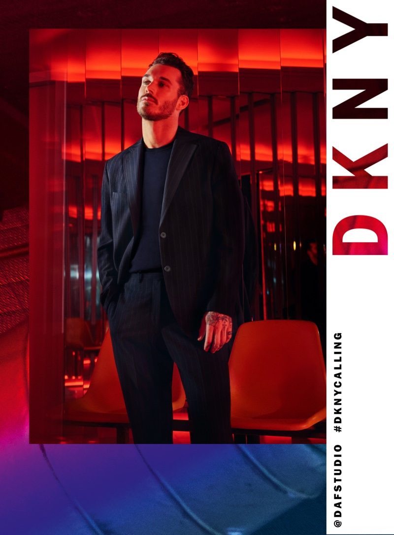 Donning a pinstripe suit, David Alexander Flinn fronts DKNY's spring-summer 2020 campaign.
