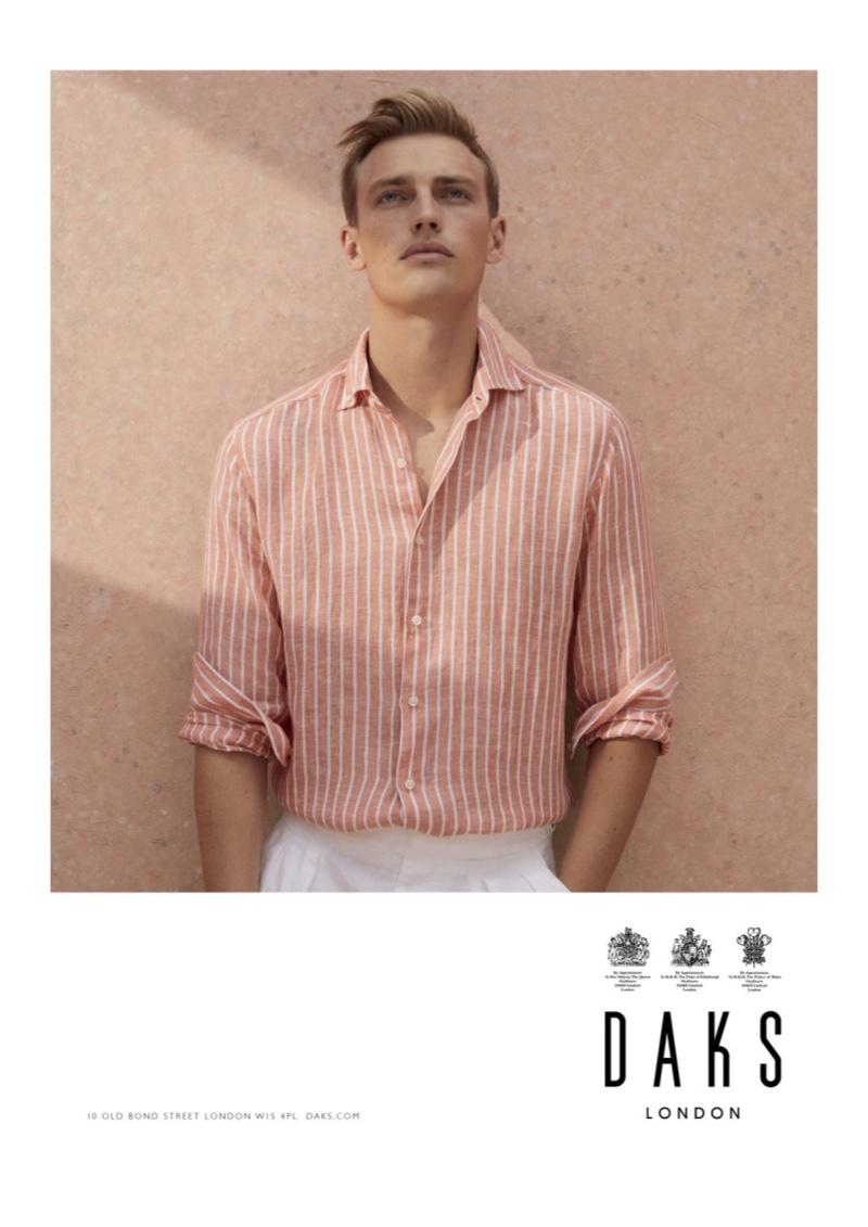 Victor Nylander dons a striped linen shirt for Daks' spring-summer 2020 campaign.