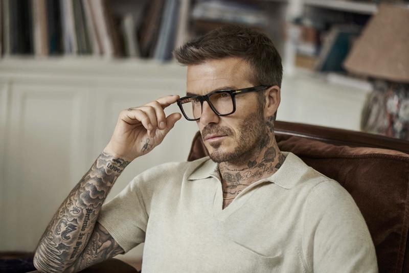 A smart vision, David Beckham dons black framed glasses from DB Eyewear.