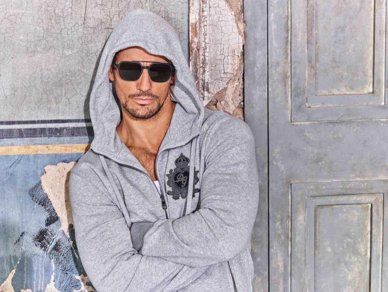 A sporty vision, David Gandy wears a gray hoodie as the star of Dolce & Gabbana's spring-summer 2020 eyewear campaign.