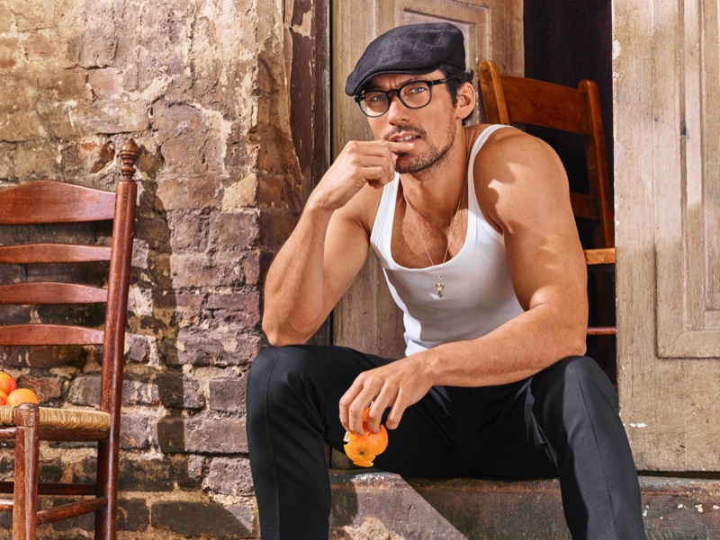 Sporting a tank and flat cap, David Gandy appears in Dolce & Gabbana's spring-summer 2020 eyewear campaign.