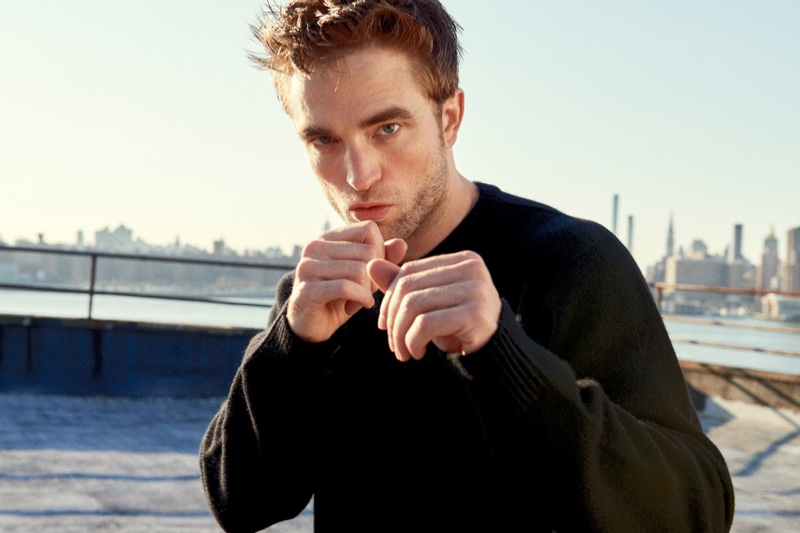 Putting up a fighting pose, Robert Pattinson stars in Dior Homme's fragrance campaign.