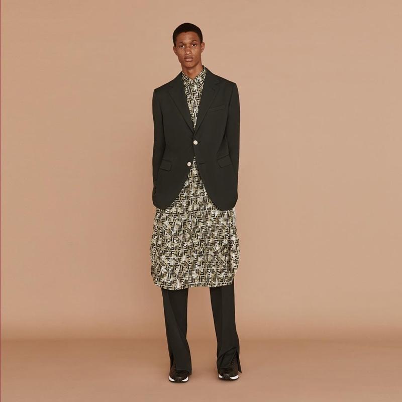 Making a case for an elongated silhouette, Romaine Dixon dons Fendi menswear.
