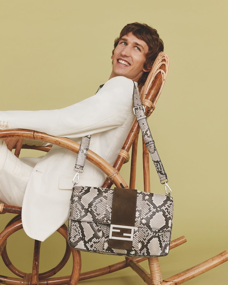 All smiles, Etienne de Testa poses with the iconic Fendi Baguette in a reptile print.