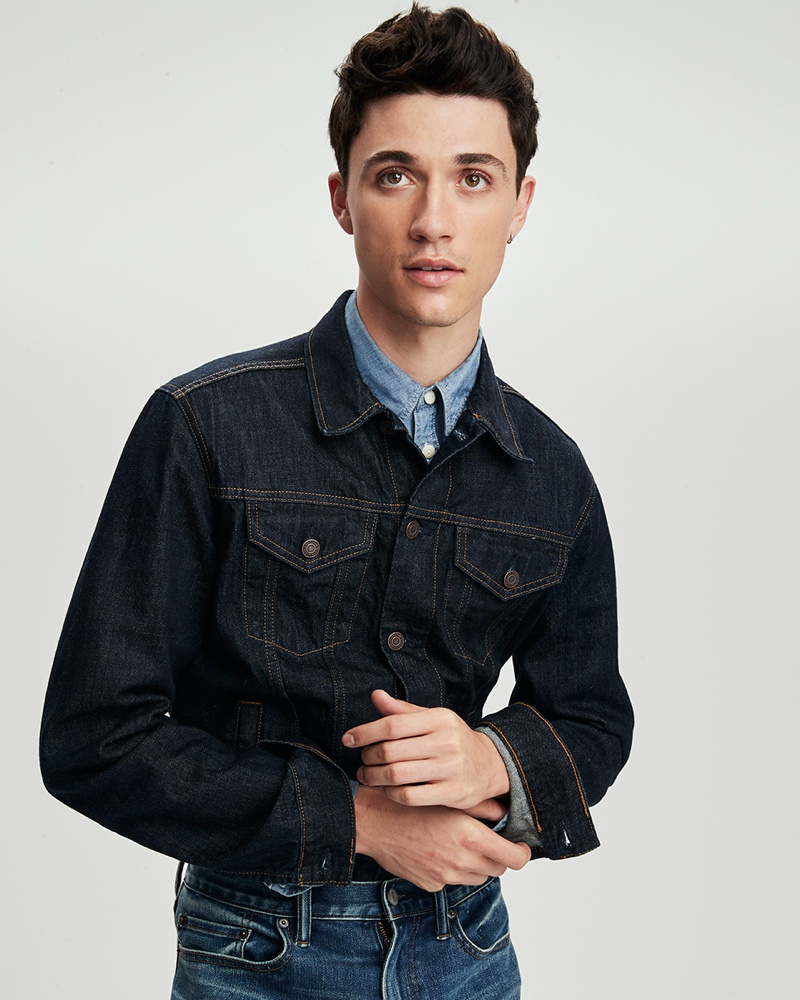 Jacob Bixenman sports a denim jean jacket, shirt, and jeans from Gap.