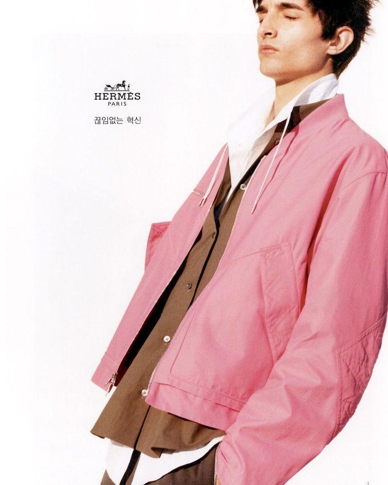 Pablo Fernandez dons a pink jacket for Hermès' spring-summer 2020 campaign.