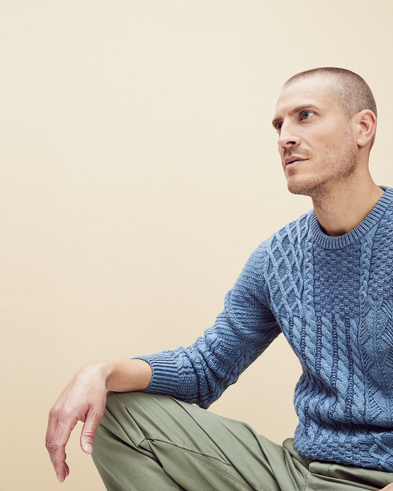 Mike Guenther models a blue cable-knit sweater by J.Crew.