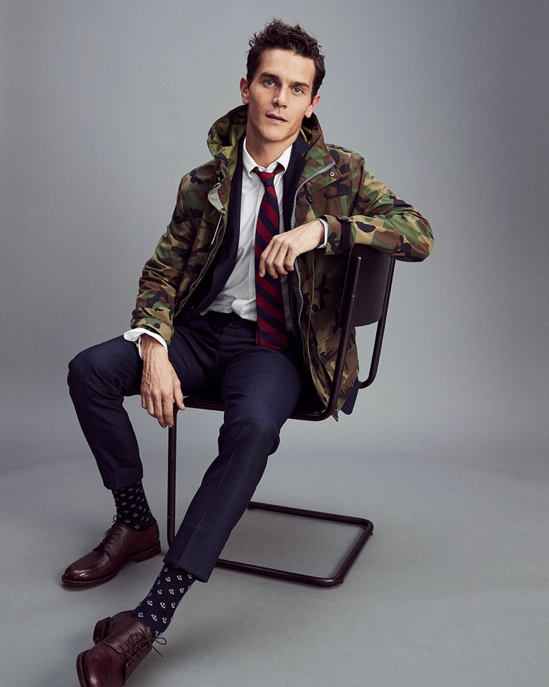 Vincent LaCrocq jazzes up a dapper J.Crew suit with a camouflage jacket.