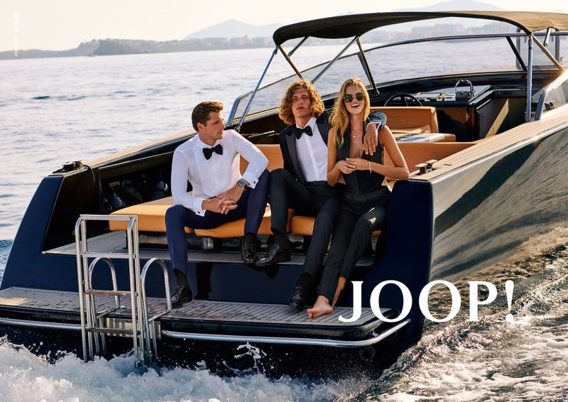 Taking to the beach, Edward Wilding, Umberto Villahermosa, and Kim Riekenberg front JOOP!'s spring-summer 2020 campaign.