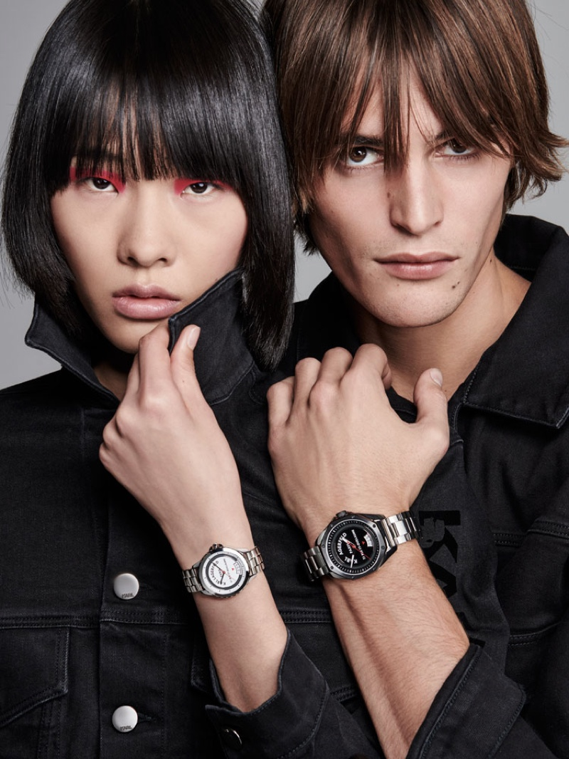 Models Ruinan Dong and Parker van Noord don spring-summer 2020 watches from Karl Lagerfeld.
